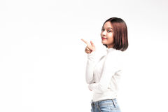 A portrait of attractive asian woman pointing at copyspace Royalty Free Stock Photo