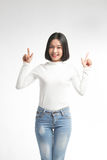 A portrait of attractive asian woman pointing at copyspace Stock Photos