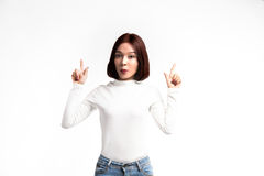 A portrait of attractive asian woman pointing at copyspace Royalty Free Stock Photography