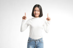 A portrait of attractive asian woman pointing at copyspace Stock Photo