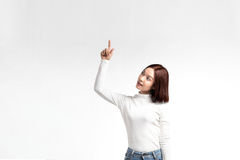 A portrait of attractive asian woman pointing at copyspace Royalty Free Stock Images