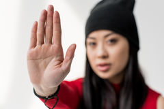 Portrait of attractive asian woman showing stop sign isolated Royalty Free Stock Photos