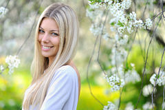 Portrait of attractive beautiful blonde woman in green blooming Stock Photo