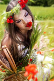Portrait of an attractive beautiful girl in a poppy field Royalty Free Stock Photography