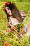 Portrait of an attractive beautiful girl in a poppy field Royalty Free Stock Images