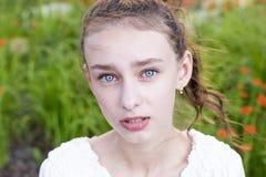 Brunette model in garden stock photo
