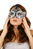 Portrait of attractive beautiful woman wearing sil. Ver carnival mask Stock Photography