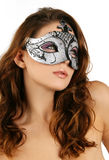 Portrait of attractive beautiful woman wearing sil. Ver carnival mask Stock Photos