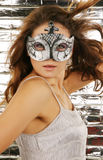 Portrait of attractive beautiful woman wearing sil. Ver carnival mask Stock Images
