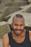 Portrait of an attractive black man smiling outdoors Stock Photo