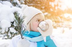 Portrait of an attractive blond girl drinks hot tea from a mug Stock Photography