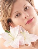 Portrait of attractive blond girl with white lily Royalty Free Stock Image