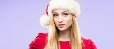 Portrait of attractive blond woman over Christmas background with snow. stock images