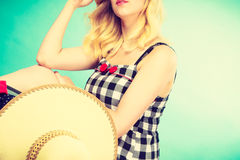 Portrait of attractive blonde woman in checked dress Royalty Free Stock Photos