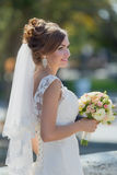 Portrait of attractive bride with bridal bouquet Royalty Free Stock Photography