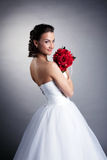 Portrait of attractive bride posing with bouquet Royalty Free Stock Images
