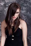 Fashion brunette in black dress stock photos