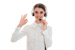 Portrait of attractive brunette call center worker girl with headphones and microphone isolated on white background stock photos