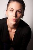 Portrait of attractive brunette girl over gray Stock Photo
