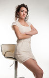 Portrait of attractive brunette girl on seat Stock Photo