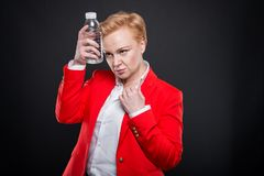 Portrait of attractive business woman cooling with bottle of wat Royalty Free Stock Photography