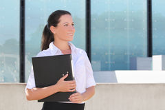 Portrait of attractive business woman with folder in the street Royalty Free Stock Photography