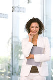 Portrait of attractive business woman holding fold Stock Images