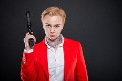 Portrait of attractive business woman holding a gun Stock Image