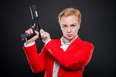 Portrait of attractive business woman loading a gun Stock Images