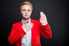 Portrait of attractive business woman making oath gesture stock photos