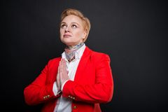 Portrait of attractive business woman making prayer gesture royalty free stock image