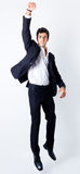 Portrait of attractive businessman. Attractive young businessman jumping with his fist in the air Stock Image