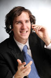 The portrait of attractive businessman. The portrait of young attractive phoned businessman Stock Images
