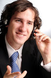 The portrait of attractive businessman. The portrait of young attractive phoned businessman Stock Image
