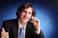 The portrait of attractive businessman. The portrait of young attractive phoned businessman Stock Photography