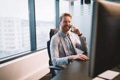 Portrait of attractive businessman in his office Royalty Free Stock Photography