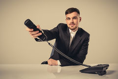 Portrait of attractive businessman holding telephone in his hand Royalty Free Stock Photos