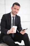 Portrait of an attractive businessman sending texts Stock Photography