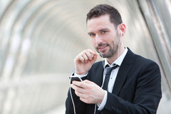 Portrait of an attractive businessman using handsfree set Royalty Free Stock Photo