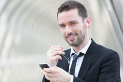 Portrait of an attractive businessman using handsfree set Stock Photo
