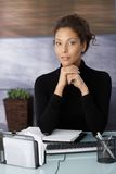 Portrait of attractive businesswoman at desk Stock Photo
