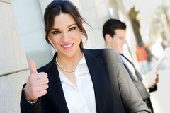 Attractive businesswoman showing thumb up sign Stock Photography