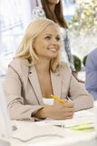 Portrait of attractive businesswoman writing Stock Photography