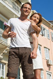 Portrait of attractive caucasian couple on sightseeing tour. Royalty Free Stock Images