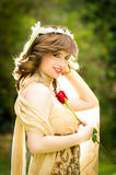 Portrait of attractive smiling woman with a rose Royalty Free Stock Photo