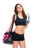 Portrait of attractive caucasian smiling woman with bottle of wa Royalty Free Stock Photo