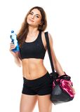 Portrait of attractive caucasian smiling woman with bottle of wa Royalty Free Stock Photography