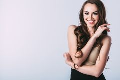 Portrait of attractive caucasian smiling woman brunette isolated on studio shot. Stock Images