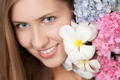 Portrait of attractive smiling woman with flowers. Portrait of attractive caucasian smiling woman with flowers Stock Photography