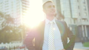 Portrait of the attractive confident businessman standing before office building stock video